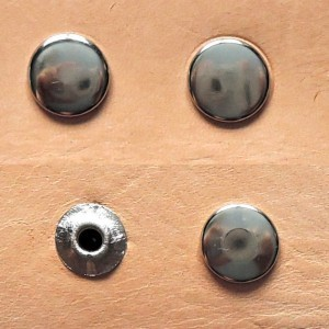 Obverse and reverse side: a) open rivet, b) closed rivet